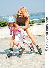 child on inline rollerblade skates