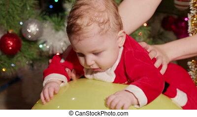 Child on massage ball