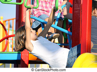child on monkey bars - a caucasian young child on monkey...