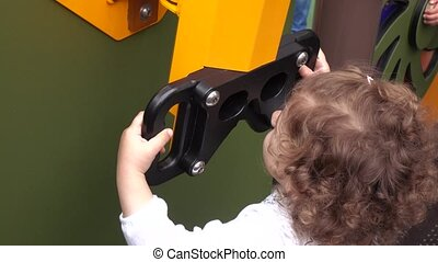 Child on playground - Curly girl playing on the playground...
