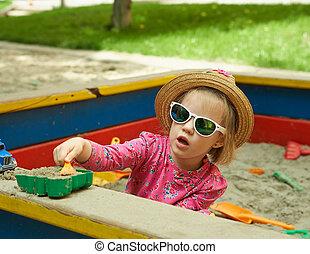 Child on playground in summer park
