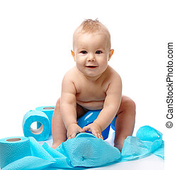 Child on potty play with blue toilet paper, isolated over white