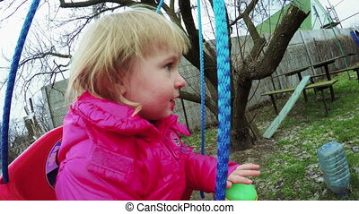 Child on swing - Little girl riding on swing