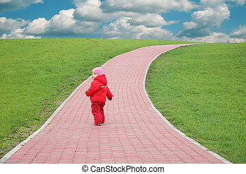 child on the field road