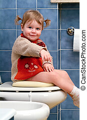 Little girl on the toilet that makes funny faces