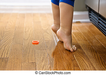 Child on tiptoe. - Feet of Caucasian toddler boy with...
