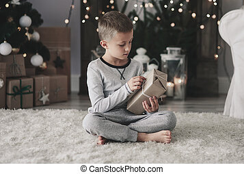 Child opening a christmas present