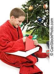 Child Opening Christmas Gift