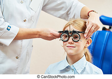 Optometry concept  test glasses phoropter with lens set for