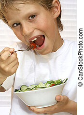 child or kid eating healthy diet of salad