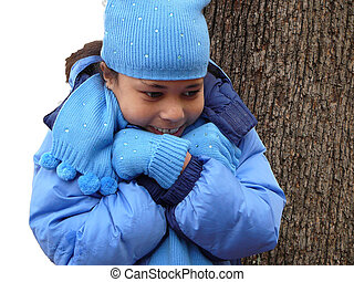 Child out in the Cold - Girl dressed for cold weather.