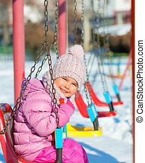 child outdoor in park at winter day