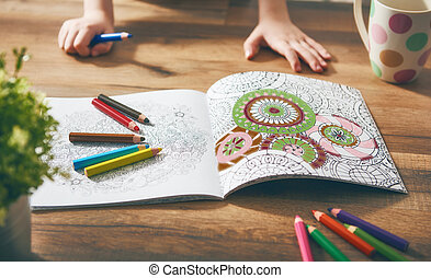 Child paint a coloring book. New stress relieving trend....