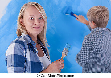 Child painting his room