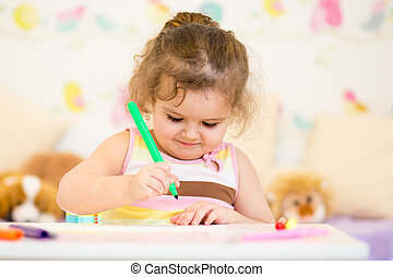 child painting in nursery at home