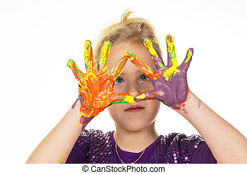 child painting with finger paints