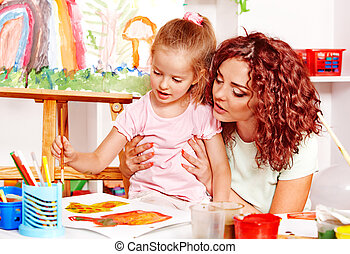 Child painting with mum. - Child with mother painting ....