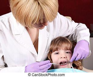 child patient at the dentist dental exam