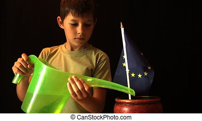 Child patriot  watering the EU flag