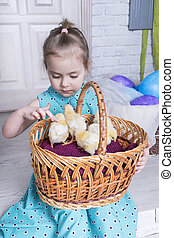 child petting a chicken
