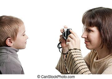 Child photograph - Women camera taking cute smiling child...