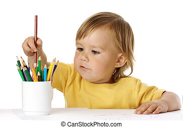 Child picking a crayon from the cup