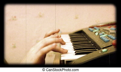 child play at piano as reel movie
