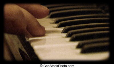 child play at piano as reel movie - close-up playing a...