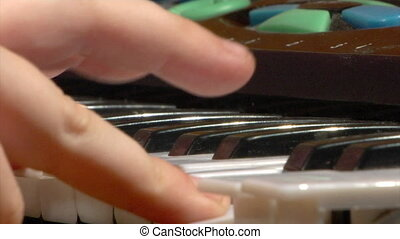 child play at toy piano