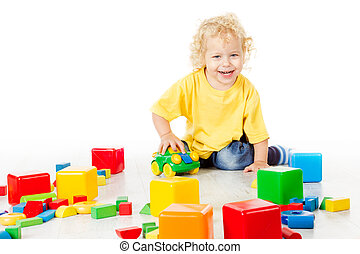 Child Play Blocks Toys, Kid Sitting on Floor and Playing Colorful Building Bricks, Baby Boy Isolated over White Background