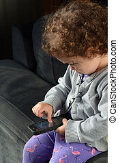 Child play on mobile phone