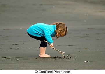 Child play on the beach