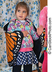 Child play pretend butterfly - Portrait of a child , little...