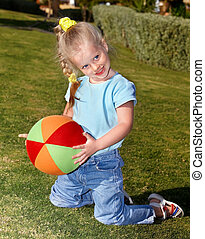 Child play with ball in park