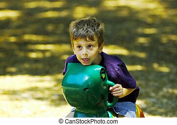 Playground - Child Playing at the Playground