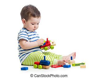 child playing construction set