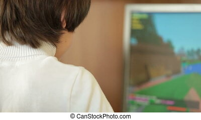 Child Playing Desktop Computer Game - Teen Boy Playing...