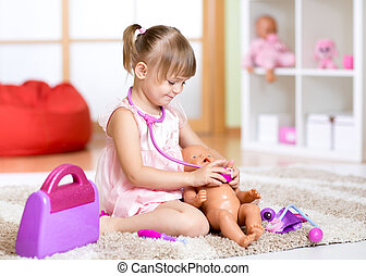 child playing doctor with toy