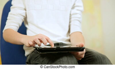 Child playing  games using tablet computer at home