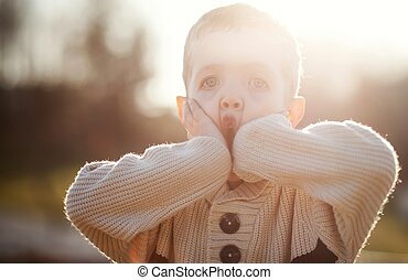 Child playing, little boy in sweater