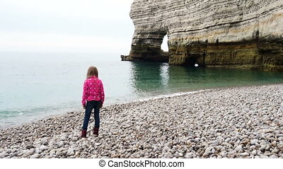 Child playing on a beach - Caucasian child girl playing on...