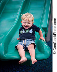 Child playing on slide