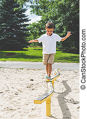 Child playing on the park play stru