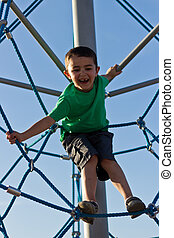 Child playing on the play structure in the park