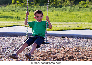Child playing on the swing