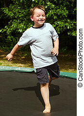 Child playing on trampoline