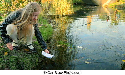Child playing paper boat