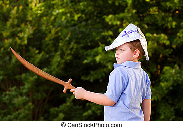 Child playing pirate outdoors