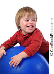 Child Playing - Child with Down Syndrome smiling playing...