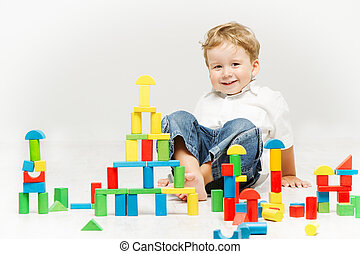 Child playing toys blocks